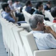 Immobilienverwalter in einer Konferenz
